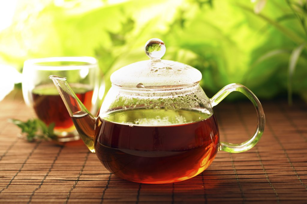 glass teapot with chinese tea, cup of herbal tea